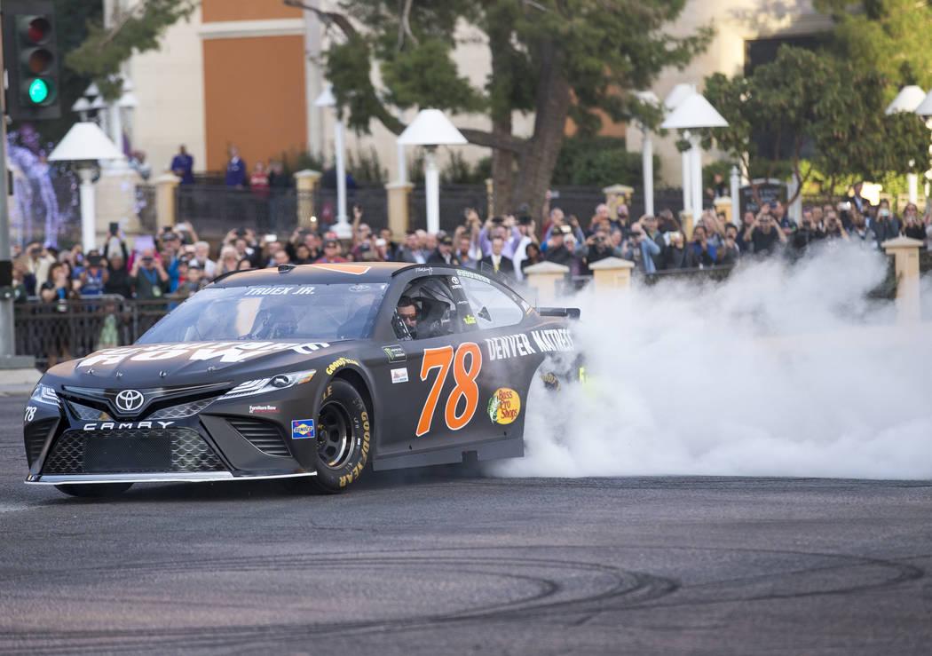 Race car driver Martin Truex Jr. (78) burns out on the Vegas Strip during NASCAR's Victory Lap on Wednesday, Nov. 29, 2017.  Richard Brian Las Vegas Review-Journal @vegasphotograph