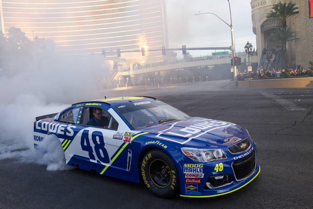 Race car driver Jimmie Johnson (48) burns out on the Vegas Strip during NASCAR's Victory Lap on Wednesday, Nov. 29, 2017.  Richard Brian Las Vegas Review-Journal @vegasphotograph