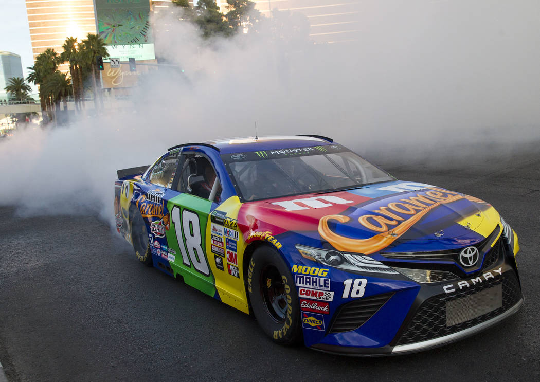 Race car driver Kyle Busch (18) burns out on the Vegas Strip during NASCAR's Victory Lap on Wednesday, Nov. 29, 2017.  Richard Brian Las Vegas Review-Journal @vegasphotograph