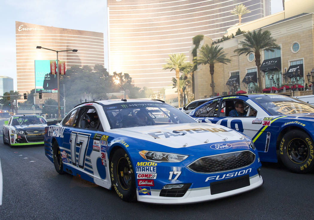 Race car driver Ricky Stenhouse Jr. (17) and other drivers take a lap on the Vegas Strip during NASCAR's Victory Lap on Wednesday, Nov. 29, 2017.  Richard Brian Las Vegas Review-Journal @vegasphot ...