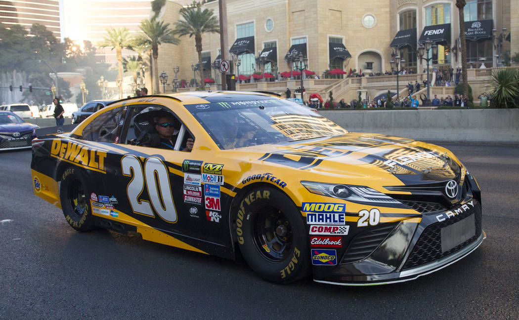 Race car driver Matt Kenseth (20) and other drivers take a lap on the Vegas Strip during NASCAR's Victory Lap on Wednesday, Nov. 29, 2017.  Richard Brian Las Vegas Review-Journal @vegasphotograph