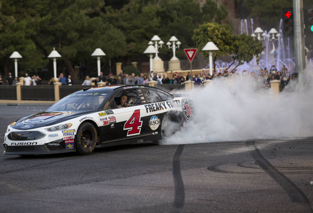 Race car driver Kevin Harvick (4) burns out on the Vegas Strip during NASCAR's Victory Lap on Wednesday, Nov. 29, 2017.  Richard Brian Las Vegas Review-Journal @vegasphotograph