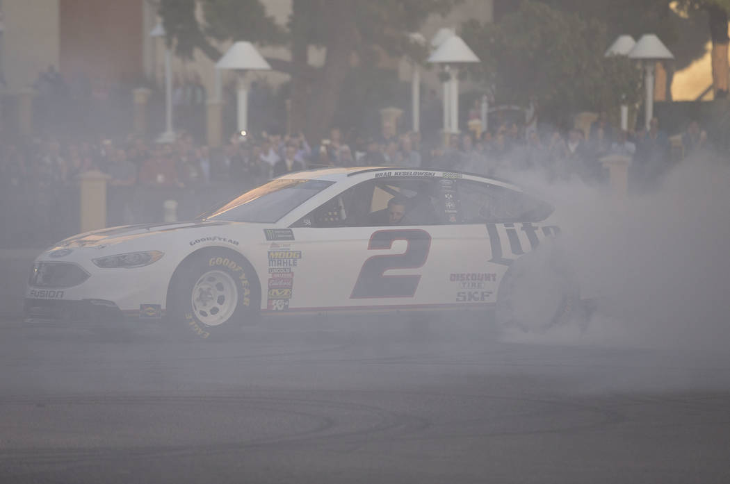 Race car driver Brad Keselowski (2) burns out on the Vegas Strip during NASCAR's Victory Lap on Wednesday, Nov. 29, 2017.  Richard Brian Las Vegas Review-Journal @vegasphotograph
