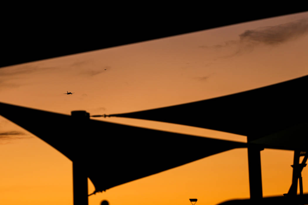 A plane is silhouetted after taking off from McCarran International Airport in Las Vegas, Thursday, Nov. 30, 2017. Joel Angel Juarez Las Vegas Review-Journal @jajuarezphoto