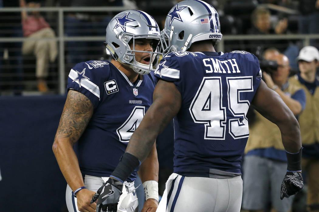 272c066d1 Dallas Cowboys quarterback Dak Prescott (4) and fullback Rod Smith (45)  celebrate