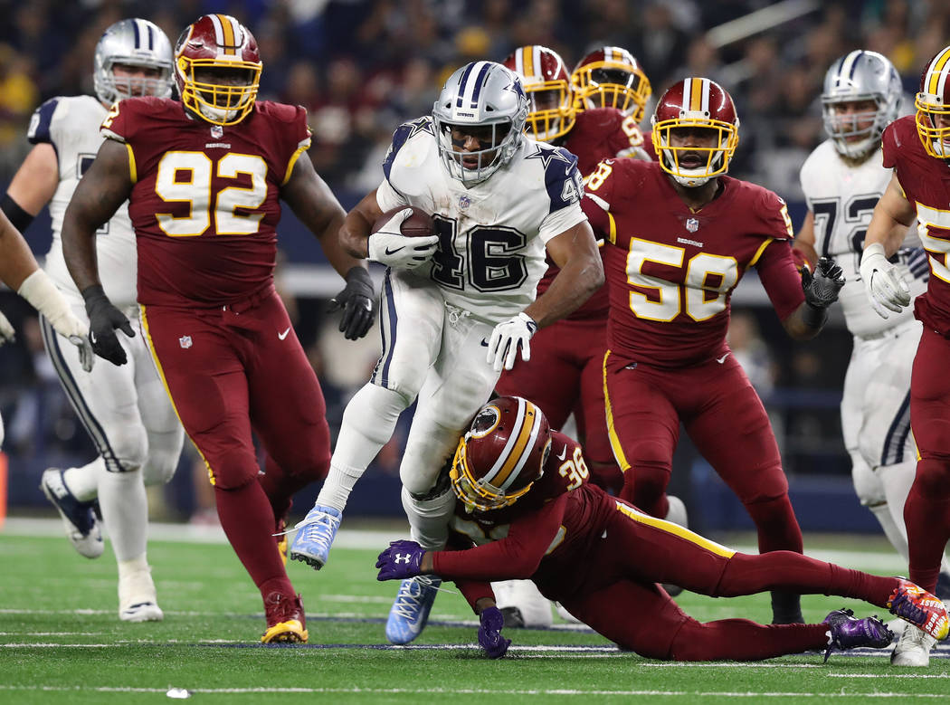 Nov 30, 2017; Arlington, TX, USA; Dallas Cowboys running back Alfred Morris (46) runs with the ball in the third quarter against the Washington Redskins at AT&T Stadium. Mandatory Credit: Matt ...