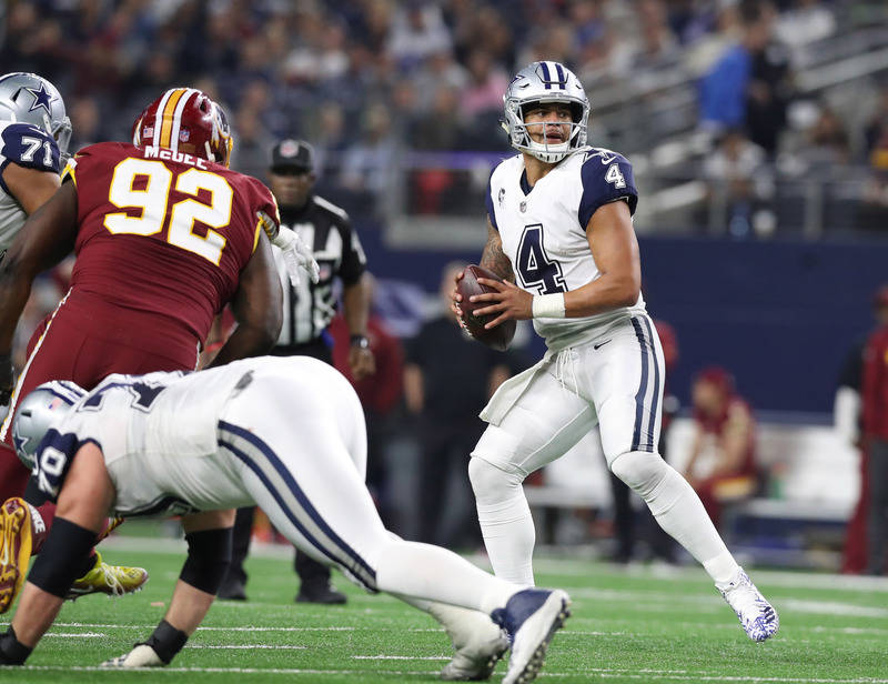 Nov 30, 2017; Arlington, TX, USA; Dallas Cowboys quarterback Dak Prescott (4) throws in the pocket in the third quarter against the Washington Redskins at AT&T Stadium. Mandatory Credit: Matth ...