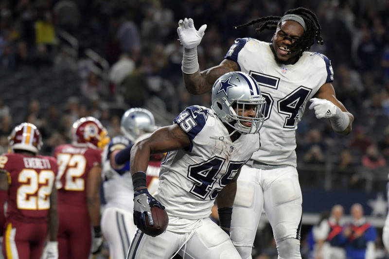 Nov 30, 2017; Arlington, TX, USA; Dallas Cowboys running back Rod Smith (45) celebrates his touchdown with Cowboys outside linebacker Jaylon Smith (54) in the second half against the Washington Re ...