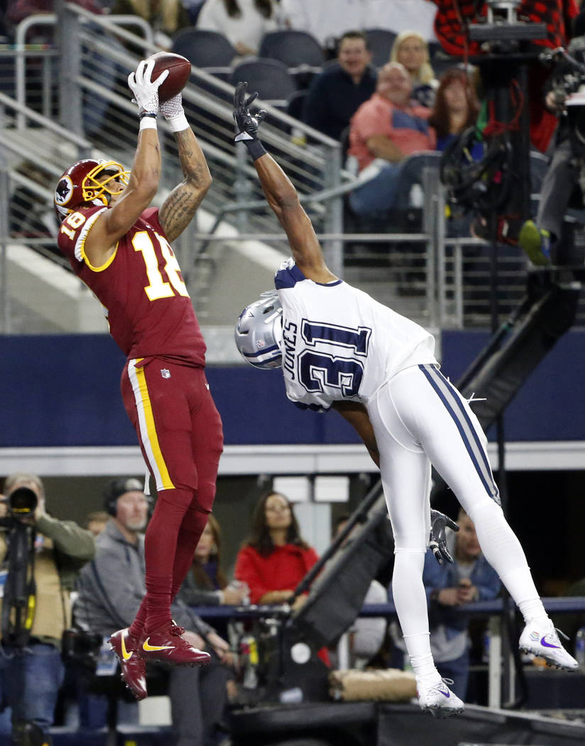 Washington Redskins wide receiver Josh Doctson (18) reaches over Dallas Cowboys safety Byron Jones (31) to catch a pass for a touchdown in the second half of an NFL football game, Thursday, Nov. 3 ...