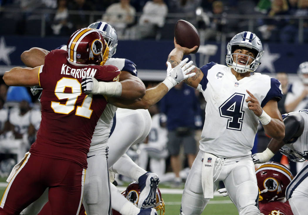 Washington Redskins linebacker Ryan Kerrigan (91) pressures Dallas Cowboys quarterback Dak Prescott (4) as Prescott throws a pass in the second half of an NFL football game, Thursday, Nov. 30, 201 ...