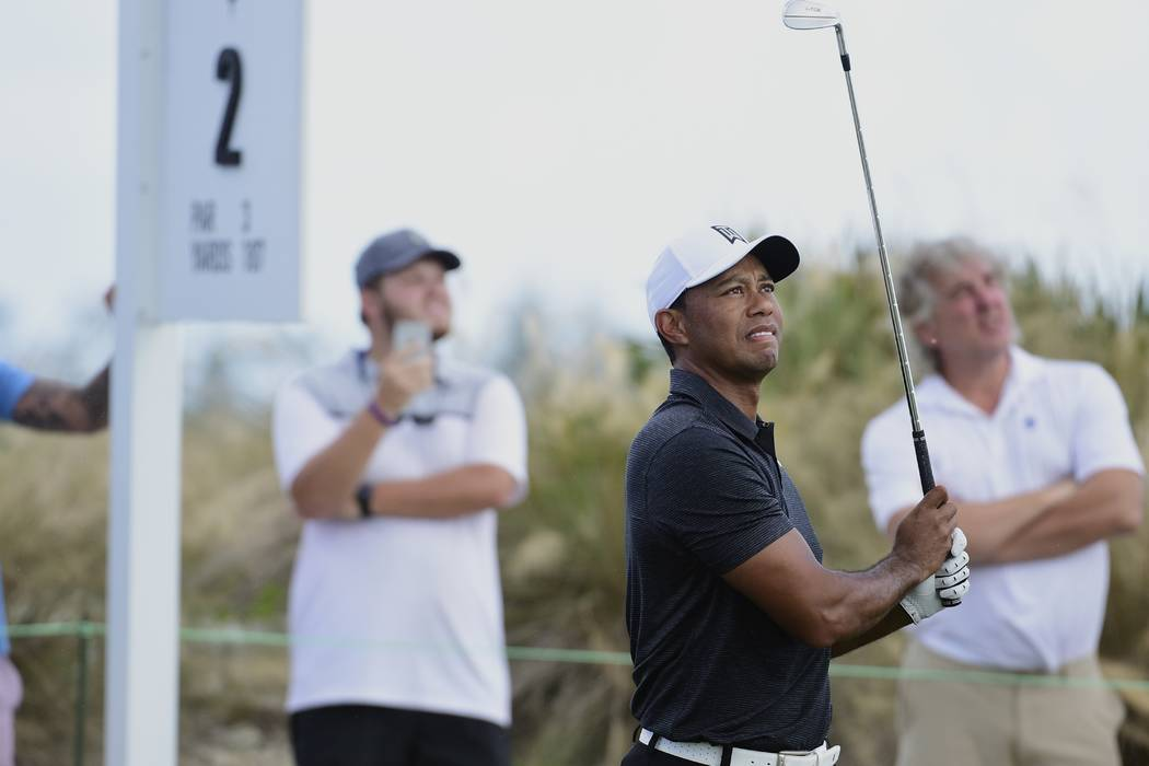 Tiger Woods tees off on the second hole at the Hero World Challenge golf tournament at Albany Golf Club in Nassau, Bahamas, Thursday, Nov. 30, 2017. (AP Photo/Dante Carrer)