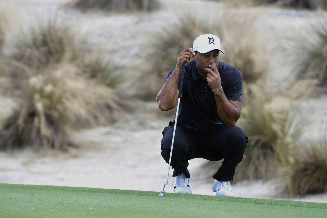 Tiger Woods prepares to hit from the second fairway at the Hero World Challenge golf tournament at Albany Golf Club in Nassau, Bahamas, Thursday, Nov. 30, 2017. (AP Photo/Dante Carrer)