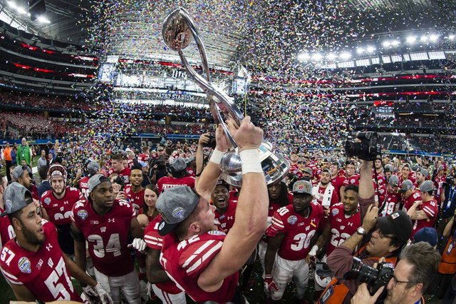 Wisconsin Badgers linebacker T.J. Watt (42) holds up the Cotton Bowl trophy after defeating the Western Michigan Broncos 24-16 at AT&T Stadium in Arlington, TX on Jan. 2, 2017. (Jerome Miron/U ...
