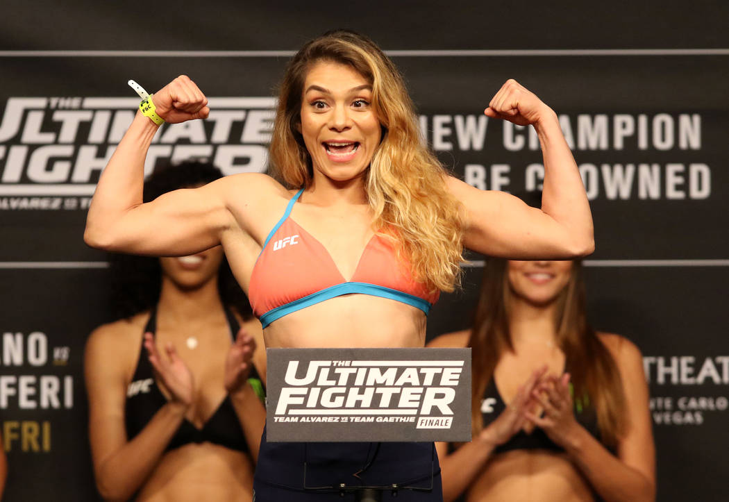 UFC flyweight title contender Nicco Montano on the scale during the ceremonial weigh-ins at the Monte Carlo hotel-casino's Park Theater in Las Vegas, Thursday, Nov. 30, 2017. Heidi Fang Las Vegas  ...