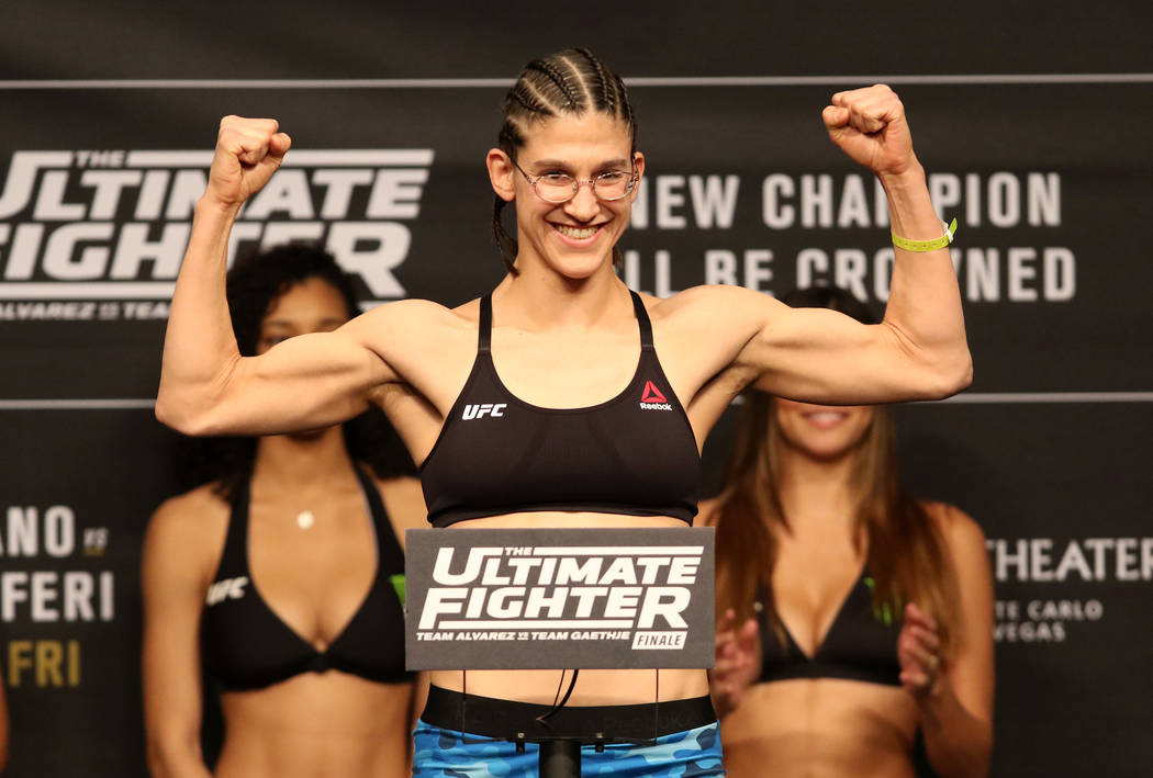 UFC flyweight title contender Roxanne Modafferi on the scale during the ceremonial weigh-ins at the Monte Carlo hotel-casino's Park Theater in Las Vegas, Thursday, Nov. 30, 2017. Heidi Fang Las Ve ...
