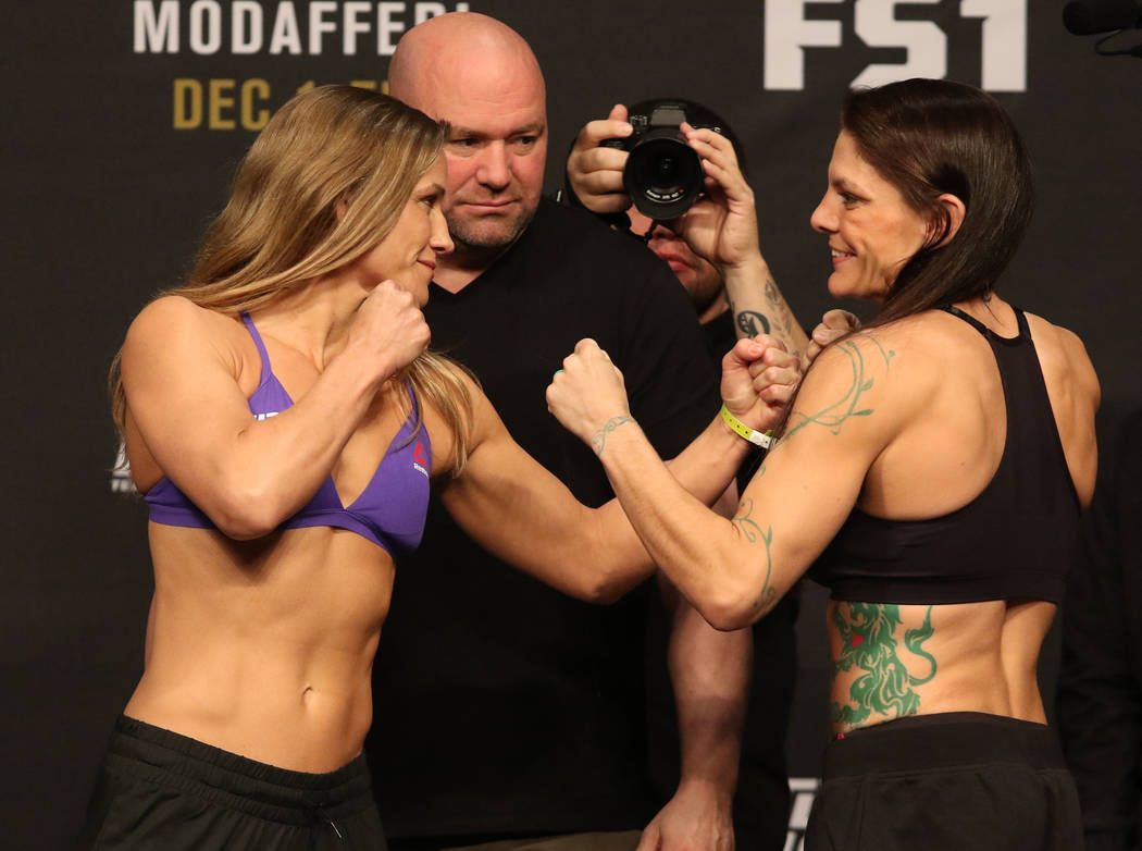 UFC flyweight Barb Honchak, left, faces off with her opponent, Lauren Murphy, right, as UFC president Dana White looks on during the TUF 26 Finale ceremonial weigh-ins at the Monte Carlo hotel-cas ...