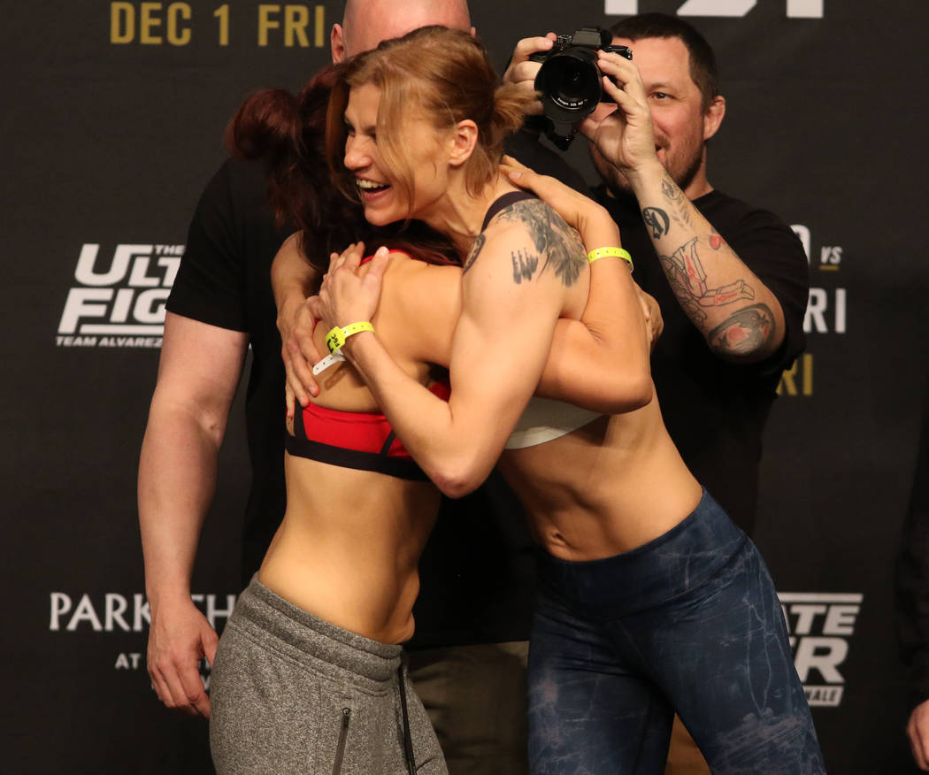 UFC flyweight DeAnna Bennett, left, gets a hug from her opponent, Melinda Fabian, right, during their staredown at the TUF 26 Finale ceremonial weigh-ins at the Monte Carlo hotel-casino's Park The ...