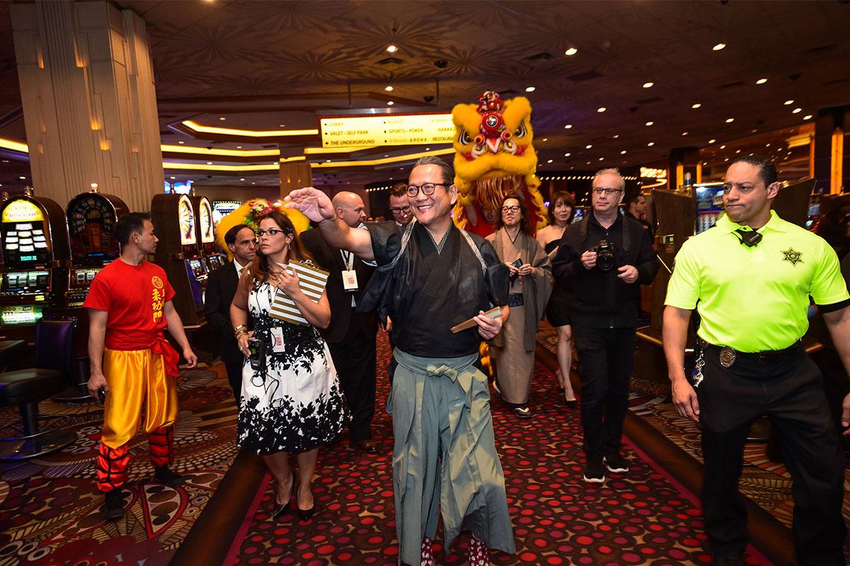 Chef-Masaharu-Morimoto-Leading-Parade-of-Lion-Dancers-through-MGM-Grand