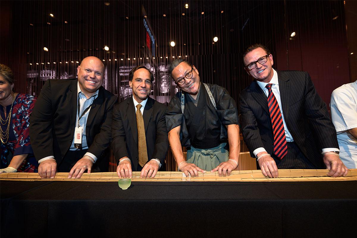 Jason-Shkorupa,-Corey-Sanders,-Chef-Masaharu-Morimoto-and-Scott-Sibella-roll-the-100-ft-long-maki-roll