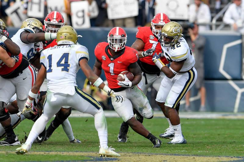 Nov 25, 2017; Atlanta, GA, USA; Georgia Bulldogs running back Sony Michel (1) runs against the Georgia Tech Yellow Jackets defense during the first half at Bobby Dodd Stadium. Mandatory Credit: Da ...