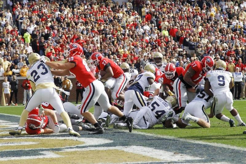 Nov 25, 2017; Atlanta, GA, USA; Georgia Bulldogs running back Nick Chubb (27) runs for a touchdown against the Georgia Tech Yellow Jackets in the first quarter at Bobby Dodd Stadium. Mandatory Cre ...
