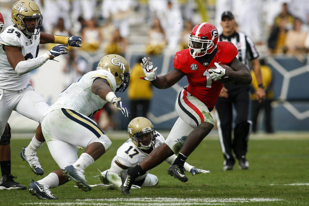 Nov 25, 2017; Atlanta, GA, USA; Georgia Bulldogs running back Sony Michel (1) runs the ball against the Georgia Tech Yellow Jackets in the third quarter at Bobby Dodd Stadium. Mandatory Credit: Br ...