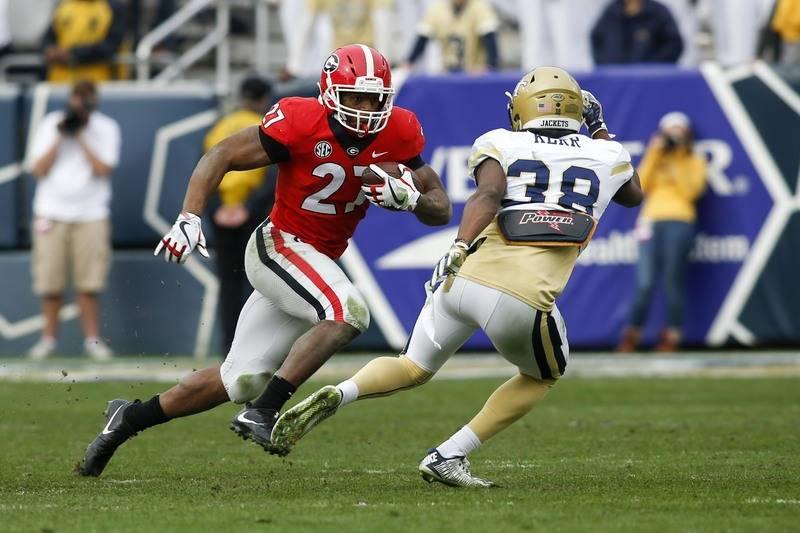 Nov 25, 2017; Atlanta, GA, USA; Georgia Bulldogs running back Nick Chubb (27) runs the ball against the Georgia Tech Yellow Jackets in the third quarter at Bobby Dodd Stadium. Mandatory Credit: Br ...