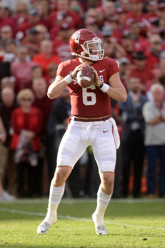 Nov 25, 2017; Norman, OK, USA; Oklahoma Sooners quarterback Baker Mayfield (6) looks to pass the ball against the West Virginia Mountaineers during the first quarter at Gaylord Family - Oklahoma M ...