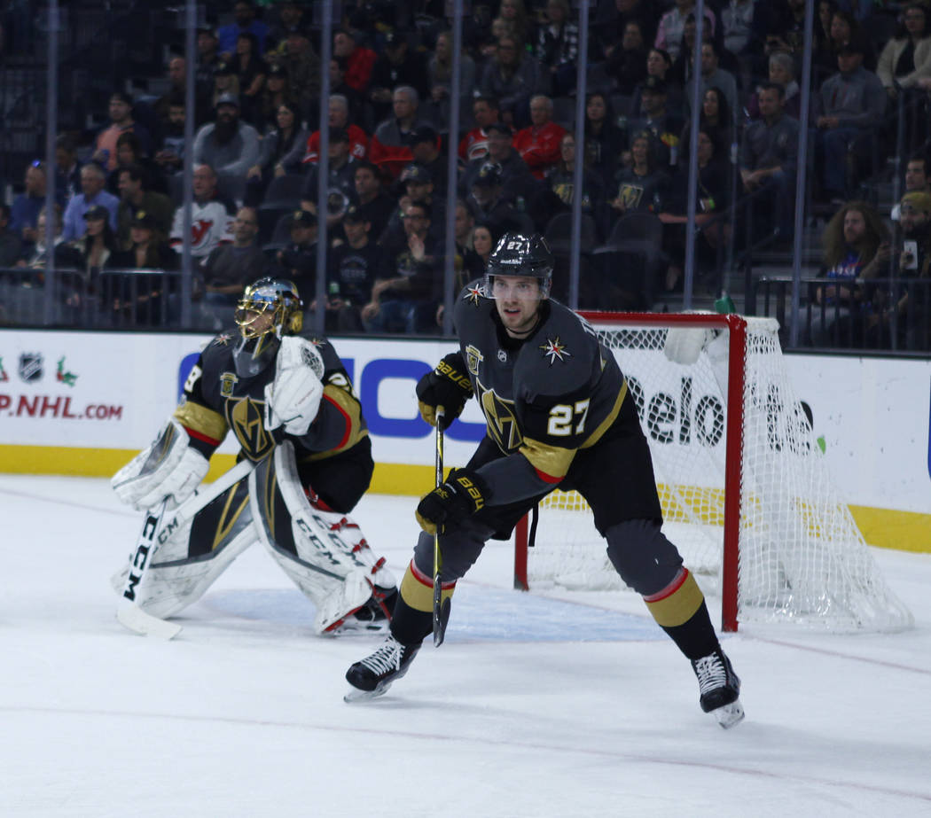 Vegas Golden Knights defenseman Shea Theodore (27) and Vegas Golden Knights goalie Marc-Andre Fleury (29) on the ice during the first period of a NHL game against the Carolina Hurricanes in Las Ve ...