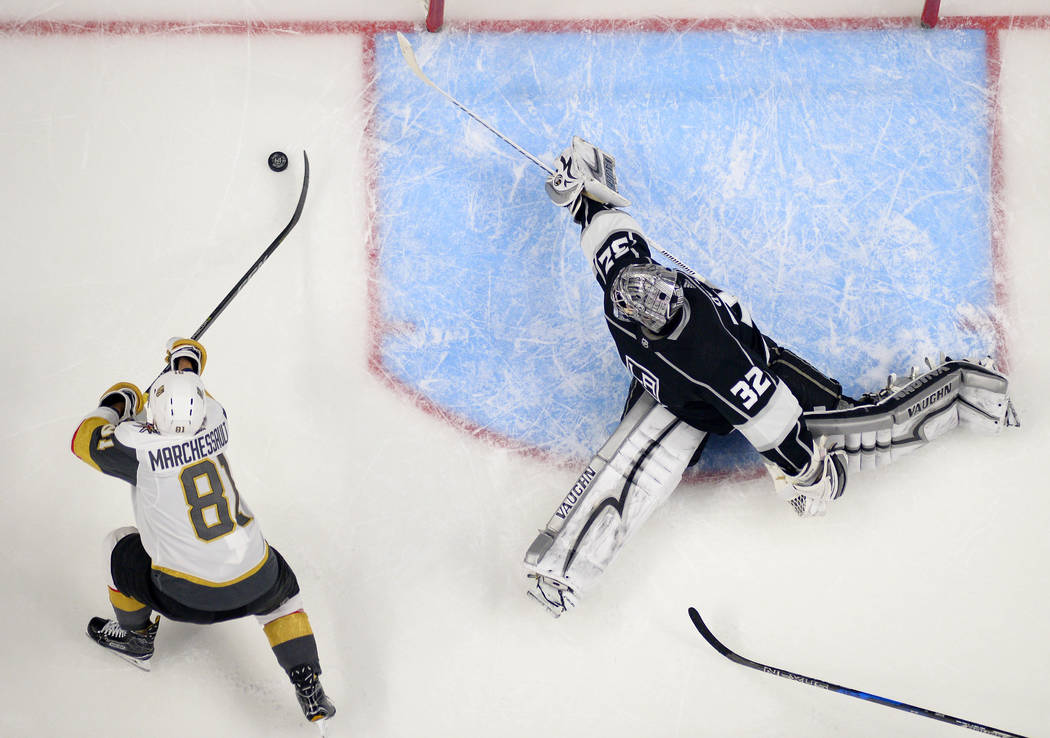 Los Angeles Kings goalie Jonathan Quick, right, gives up a goal to Vegas Golden Knights center Jonathan Marchessault during the second period of an NHL hockey game Thursday, Dec. 28, 2017, in Los  ...