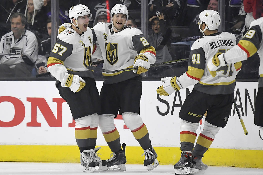Vegas Golden Knights left wing David Perron, left, celebrates his game-winning goal with defenseman Shea Theodore, center, and left wing Pierre-Edouard Bellemare, of France, during the overtime an ...