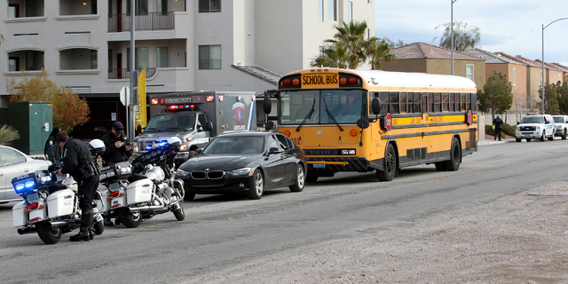 Las Vegas police investigate a crash involving a school bus on Cactus Avenue near Bermuda Road Thursday, Jan. 19, 2017. Of the 45 students on the bus, six complained of possible injuries. All were ...