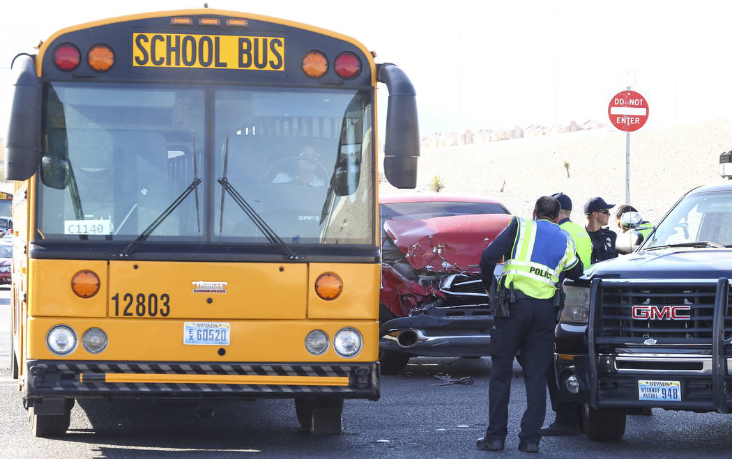 The scene of an accident where a Clark County School District school bus collided with a pickup truck on North Durango Drive near the 215 Beltway in northwest Las Vegas on Thursday, Oct. 19, 2017. ...