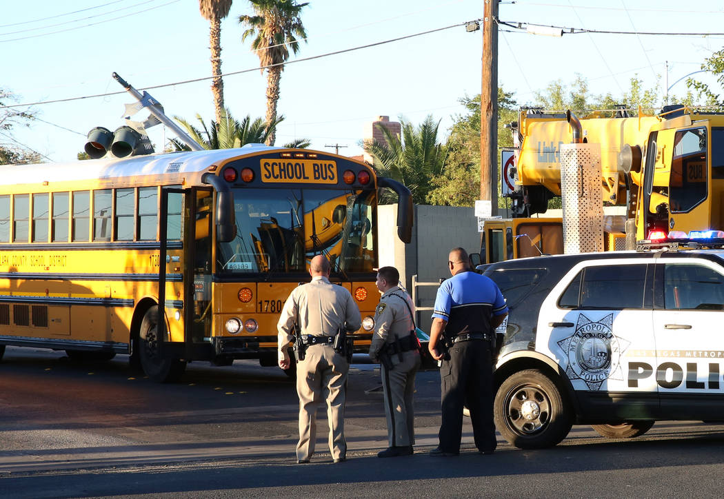 Las Vegas police investigate after a crane truck from Dielco crane service hit the street light and the pole fell on the Clark County School District bus on Arville Street and Oakey Boulevard on T ...