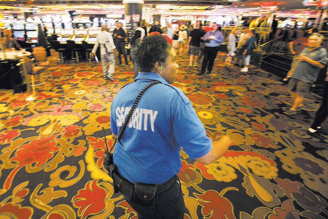 A security officer escorts the last of the gamblers out of the Riviera hotel-casino in 2015. (Las Vegas Review-Journal)