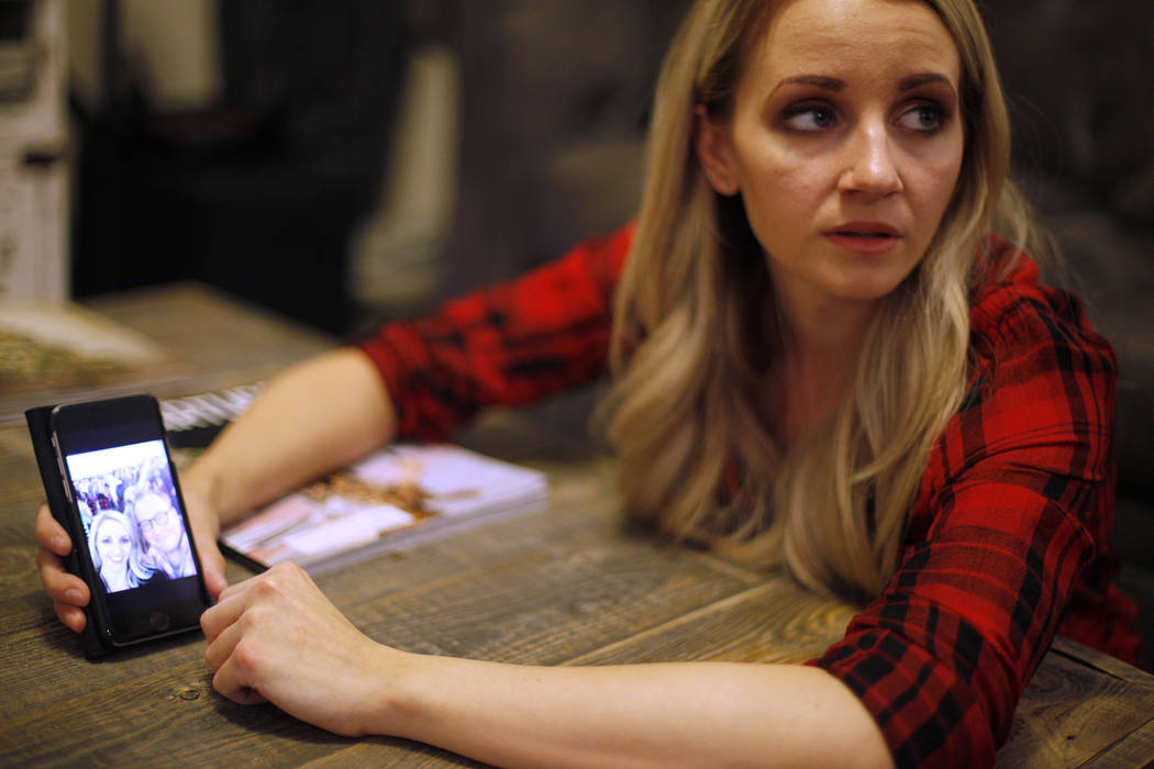 Chantal McCrorie shows the Review-Journal a photo from the Route 91 Harvest Festival with her friend, at her home in Las Vegas, Wednesday, Nov. 15, 2017. McCrorie survived the Route 91 shooting. S ...