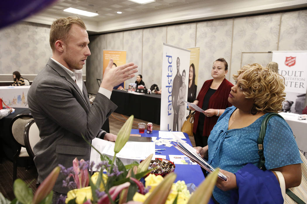 Corey Gerwaski, left, marketing manager at Randstad, talks to Valerie Frazier during a hiring event at Palace Station on Thursday, Nov.16, 2017, in Las Vegas. Bizuayehu Tesfaye Las Vegas Review-Jo ...