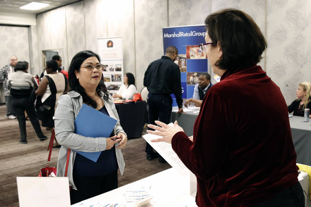 Victoria Gasca, recruiting manager at Binion's, talks to Felicidad Garcia during a hiring event at Palace Station on Thursday, Nov.16, 2017, in Las Vegas. Bizuayehu Tesfaye Las Vegas Review-Journa ...