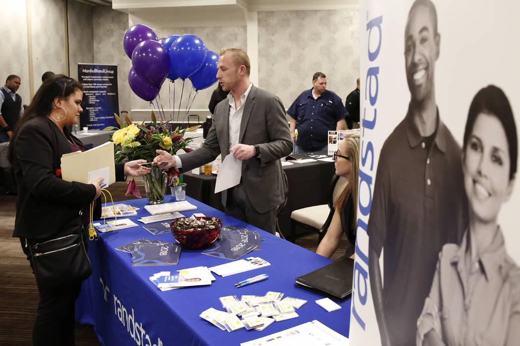 Corey Gerwaski, marketing manager at Randstad, talks to Mandrell Hahn, left, during a hiring event at Palace Station on Thursday, Nov.16, 2017, in Las Vegas. Bizuayehu Tesfaye Las Vegas Review-Jou ...