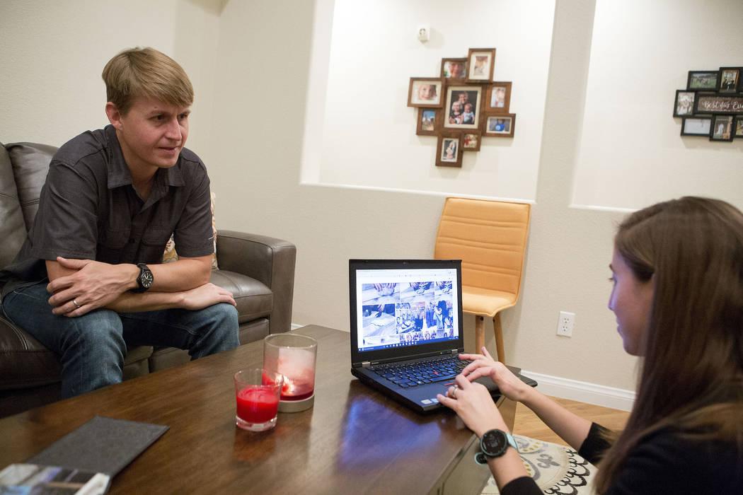 Shane Peterson, left, and his current wife, Rachel Lipman, look through photos of his daughters at his home in Henderson on Nov. 15, 2017. Bridget Bennett Las Vegas Review-Journal @BridgetKBennett