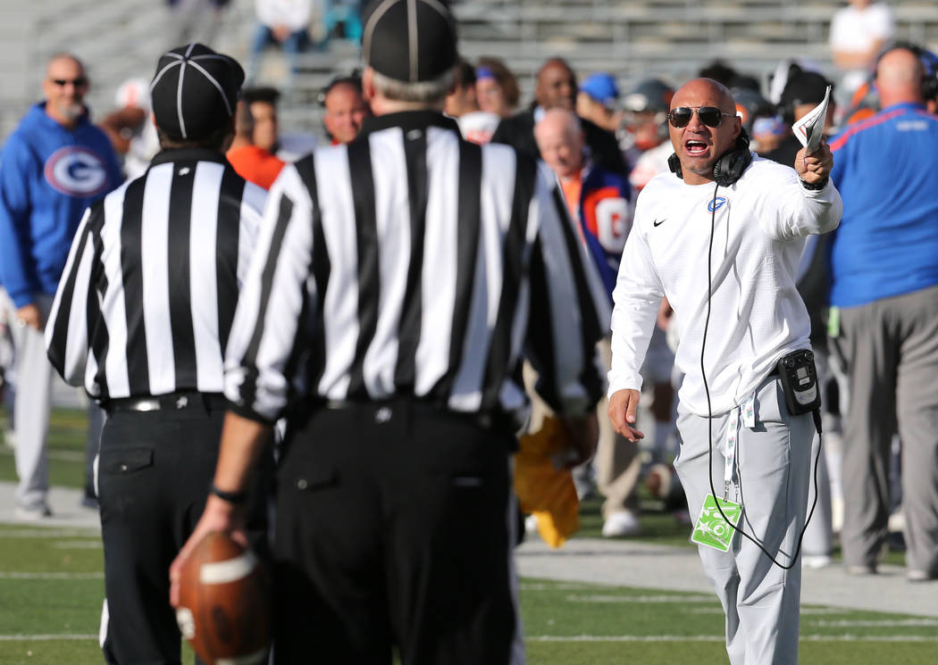Bishop Gorman head coach Kenny Sanchez draws an unsportsmanlike penalty after yelling at the referees in the NIAA 4A state championship football game in Reno, Nev., on Saturday, Dec. 2, 2017. Gorm ...