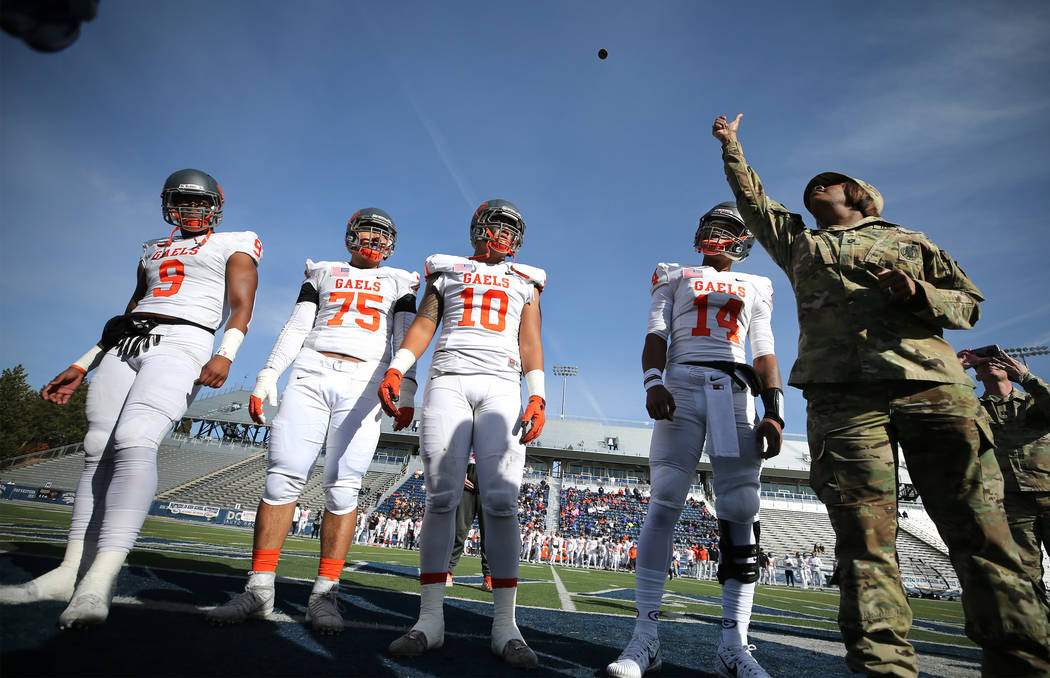 The Bishop Gorman captains call the coin toss at the start of the NIAA 4A state championship football game in Reno, Nev., on Saturday, Dec. 2, 2017. Gorman defeated Reed 48-7. Cathleen Allison/Las ...