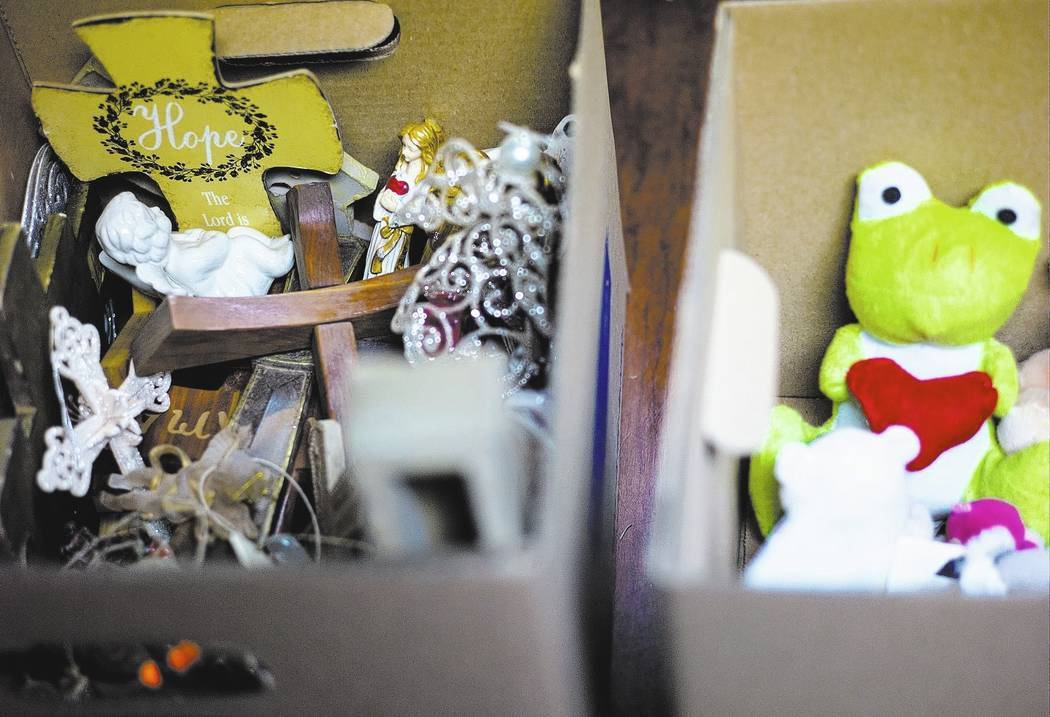Items from memorials relating to the Oct. 1 shooting on the Las Vegas Strip are grouped into boxes at the museum in Henderson on Wednesday, Nov. 15, 2017. Each item will be individually cataloged. ...