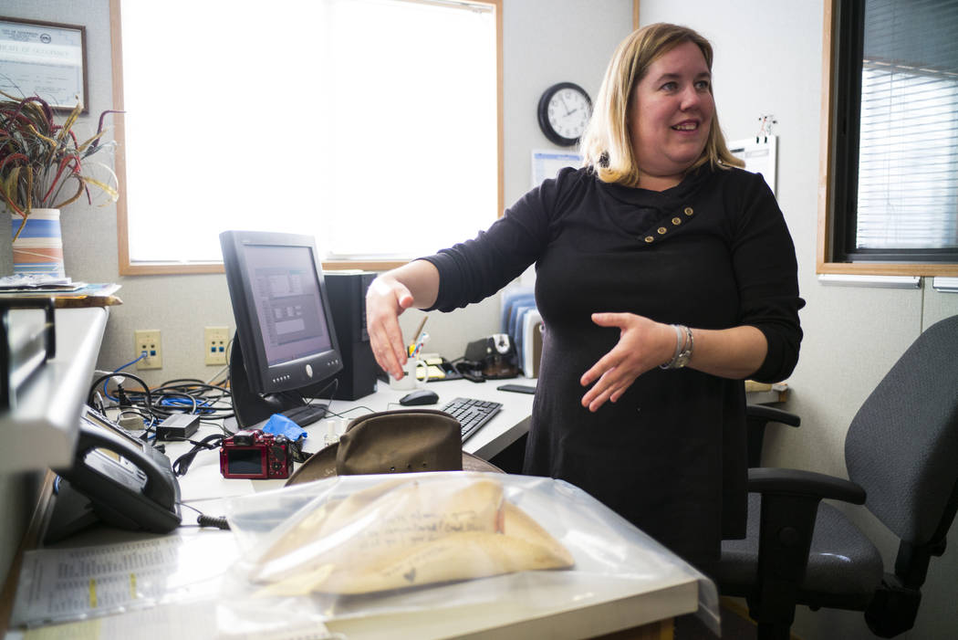 Cynthia Sanford, registrar at the Clark County Museum, talks about the process of cataloging items from memorials relating to the Oct. 1 shooting at the museum in Henderson on Wednesday, Nov. 15,  ...