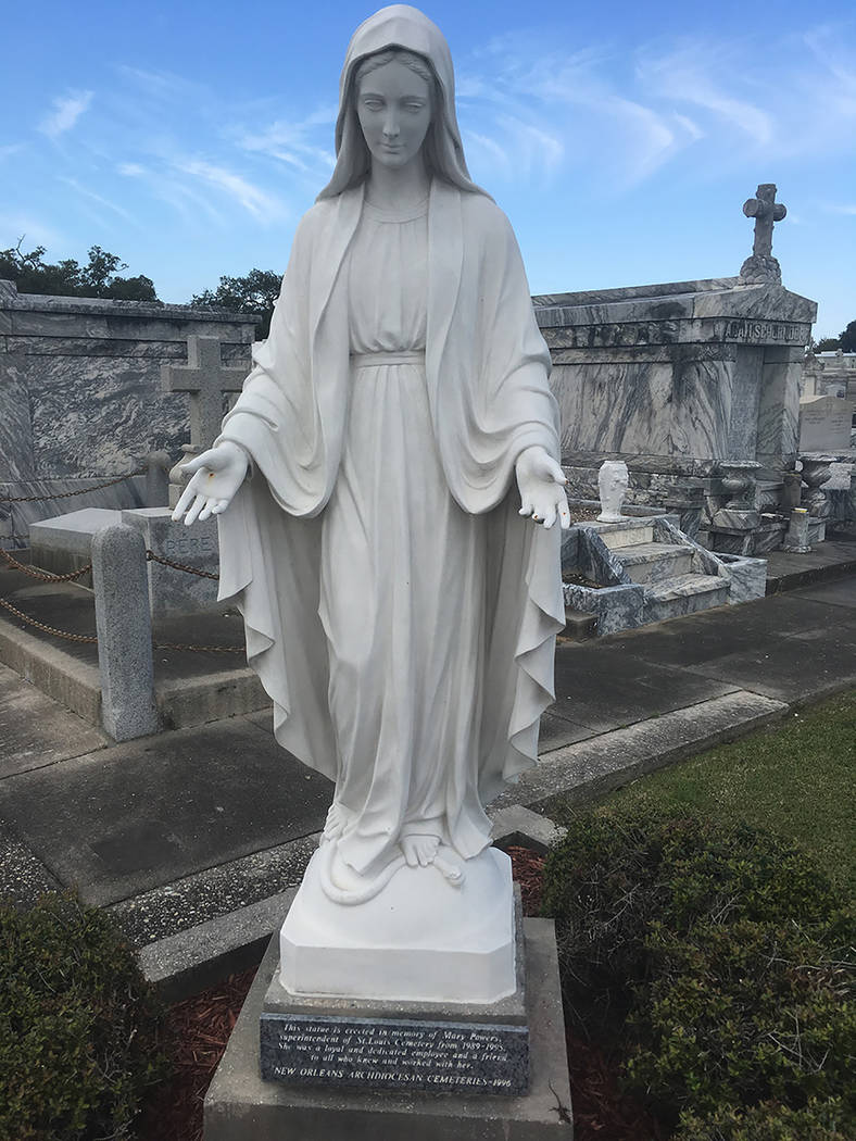 New Orleans' crypt-filled above-ground cemeteries are among its many distinctive features. This one, at St. Louis Cemetery No. 3, is dedicated to former cemetery superintendent Mary Powers. ...