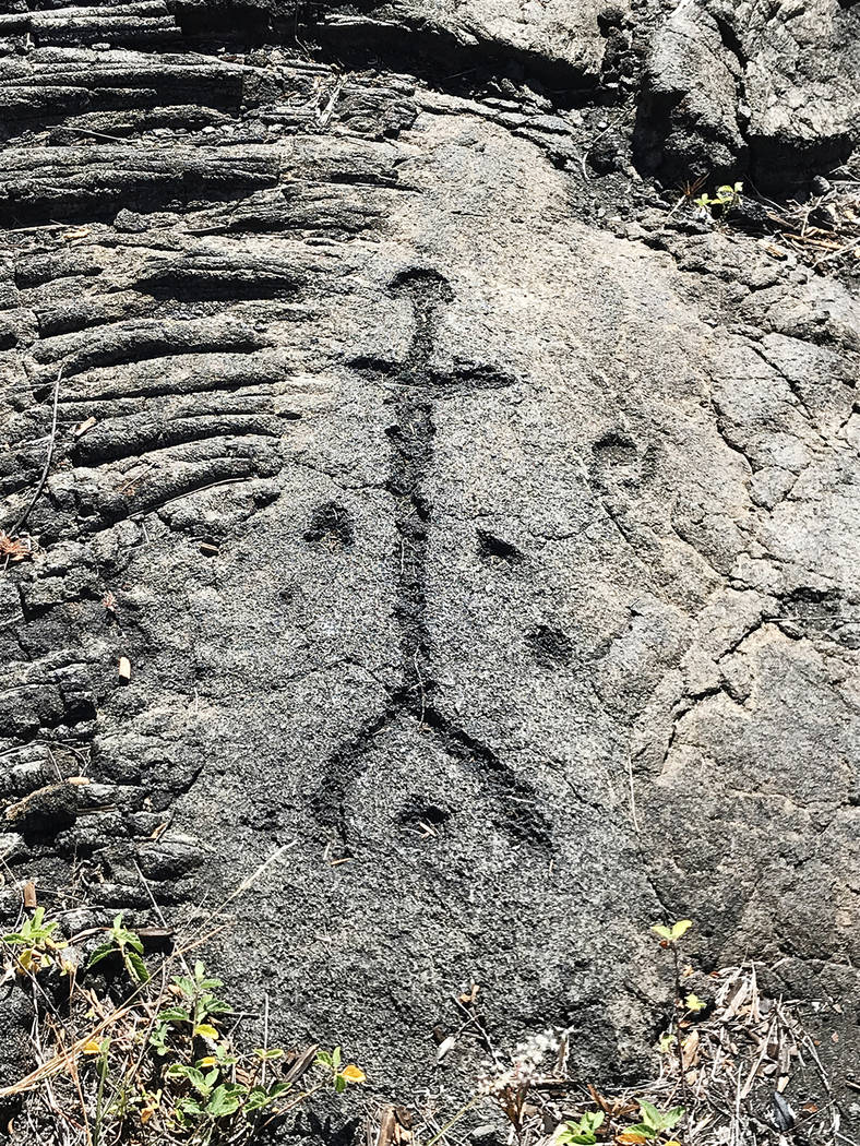 Ancient Hawaiian culture lacked a written language, but these Pu'uloa petroglyphs in Hawaii Volcanoes National Park depict the lives of early Hawaiian people. (Jeff Mosier)