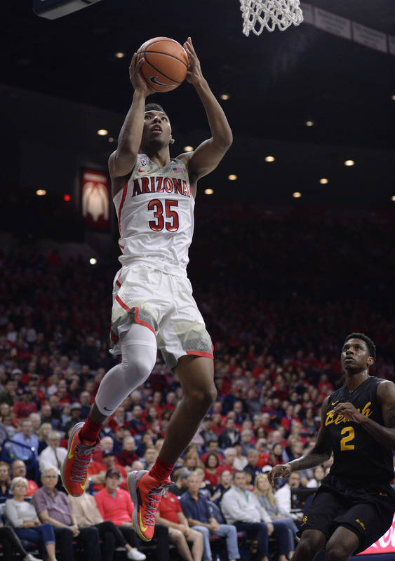 Nov 29, 2017; Tucson, AZ, USA; Arizona Wildcats guard Allonzo Trier (35) shoots the ball in front of Long Beach State 49ers forward Javonntie Jackson (2) during the second half at McKale Center. M ...