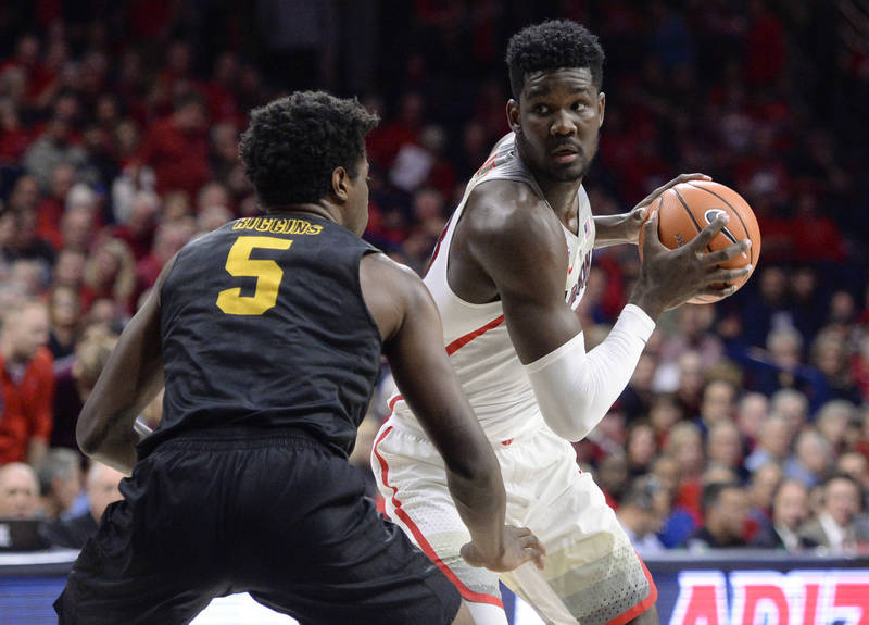 Nov 29, 2017; Tucson, AZ, USA; Arizona Wildcats forward Deandre Ayton (13) looks to pass the ball as Long Beach State 49ers forward Mason Riggins (5) defends during the first half at McKale Center ...