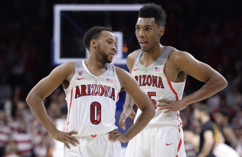 Nov 29, 2017; Tucson, AZ, USA; Arizona Wildcats guard Parker Jackson-Cartwright (0) and guard Allonzo Trier (right) talk during the first half against the Long Beach State 49ers at McKale Center.  ...