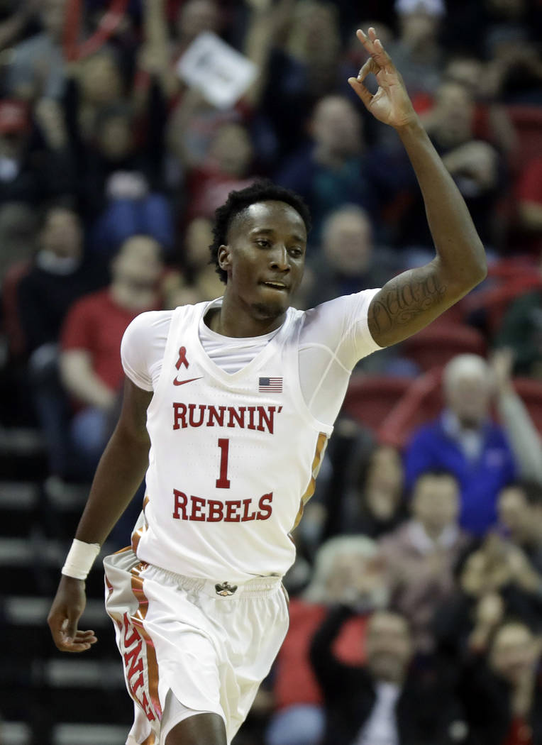 UNLV's Kris Clyburn celebrates after sinking a 3-point shot during the first half of an NCAA college basketball game against Arizona on Saturday, Dec. 2, 2017, in Las Vegas. (AP Photo/Isaac Brekken)